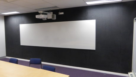 picture of a Vista matt projection whiteboard with Casio short throw projector