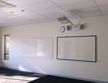 Photo of a TG-850 and short throw projector